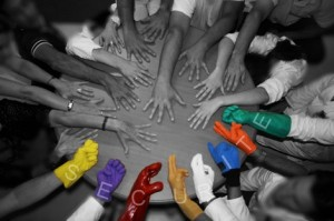 Image of employees' hands signifying working together